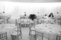 Tables and chairs round in a white ballroom Stock Photos