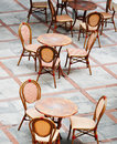 Tables and chairs in a street cafe Stock Image