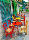 Tables chairs on a street cafe ioannina greece Royalty Free Stock Photo