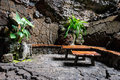 Tables and chairs in volcanic cave, Spain Royalty Free Stock Photo