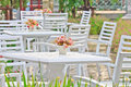 Tables, chairs, white outdoor patio Stock Photos