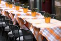 Tables laid with checkered tablecloth for a stylish italian rest typical restaurant Royalty Free Stock Photos