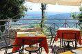 Tables outdoor restaurant in the fortress of San Marino. Royalty Free Stock Photo