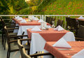 Tables at the restaurant served for a supper on an open terrace Stock Photography