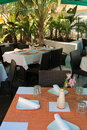 Tables set for dinner at outdoor restaurant Royalty Free Stock Photo