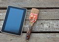Tablet and brush on wood background Royalty Free Stock Photo