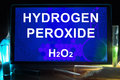 Tablet with chemical formula of  hydrogen peroxide. Royalty Free Stock Photo