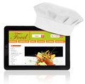 Tablet computer with chef hat and recipe website template isolated Stock Images