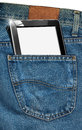 Tablet computer in a pocket of blue jeans fabric with black with blank pages Royalty Free Stock Image