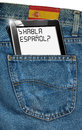 Tablet computer spanish everywhere jeans with black with phrase habla español in a pocket and label with flag of spain concept to Royalty Free Stock Image
