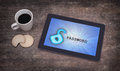 Tablet on a desk concept of data protection blue Royalty Free Stock Photography