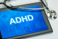 Tablet with the diagnosis adhd on display Royalty Free Stock Images