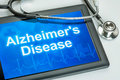 Tablet with the diagnosis alzheimer s disease on display Stock Images