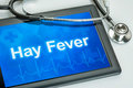 Tablet with the diagnosis hay fever on display Stock Photos
