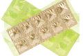 Tablet in gold aluminum strip pack show medicine concept Royalty Free Stock Photo