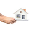 Tablet in hand touch screen and shows house on Royalty Free Stock Image