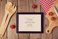 Tablet mock up template with cooking utensil. Royalty Free Stock Photo