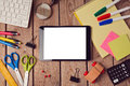 Tablet mock up template with school supplies over wooden surface. Back to school concept Royalty Free Stock Photo