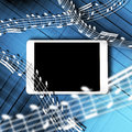 Tablet music concept with blank screen and notes splashing out of it Royalty Free Stock Image