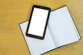 Tablet over agenda electronic on a hard cover with blank pages Royalty Free Stock Image