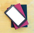 Tablet over books digital with blank screen hard cover Royalty Free Stock Photo