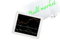 Tablet and paper with text bull market is isolated on transparen Royalty Free Stock Photo