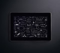 A tablet pc on a black background computer with business plan concept drawing the screen Royalty Free Stock Images