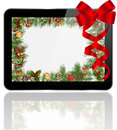 Tablet pc christmas gift with decoration Royalty Free Stock Image