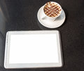 Tablet pc and coffee mugs with fresh cup of view from above Royalty Free Stock Images