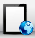 Tablet pc with globe Stock Image