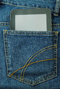 Tablet pc in the pocket of jeans black blue Royalty Free Stock Images