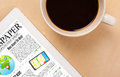 Tablet pc shows news on screen with a cup of coffee on a desk workplace showing and wooden work table close up Royalty Free Stock Photo