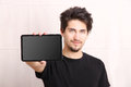 Tablet pc a young hispanic man holding a Stock Photography