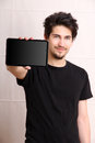Tablet pc a young hispanic man holding a Stock Images
