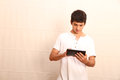 Tablet pc a young latin man with a face in focus Stock Photo