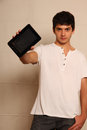 Tablet pc a young latin man with a face in focus Royalty Free Stock Photography