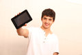Tablet pc a young latin man with a in focus Stock Photo