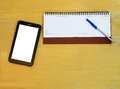 Tablet and planner with copy space a daily on an office desk Stock Image