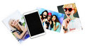 Tablet and printed photos on white background Stock Photo