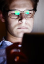 Tablet reflect glasses on a young man Royalty Free Stock Photos