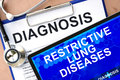 Tablet with restrictive lung diseases form word diagnosis and Royalty Free Stock Image