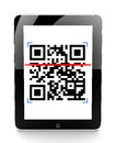 Tablet scanning a code Royalty Free Stock Photo