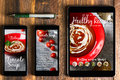 With tablet and smartphone healthy recipes blog on screen. Web o Royalty Free Stock Photo