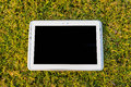 Tablet touch screen digital in the grass field Royalty Free Stock Photography