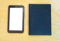 Tableta y libro Fotografía de archivo