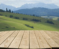 Tabletop with mountain view empty wooden in the background Royalty Free Stock Images
