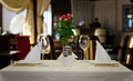 Tabletop setting design for two people close up elegant inside an expensive restaurant Stock Photos