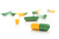 Tablets capsules pills yellow green  Stock Photography