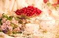 Tableware, raspberry, cherry and flowers Stock Photos