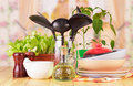 Tableware set with herbs on the wooden table and kitchen background Royalty Free Stock Photo